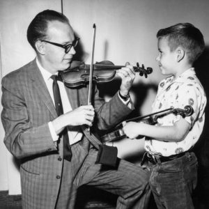 Robert Warren w/ young Suzuki student